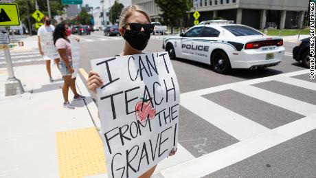 Middle-school teacher Brittany Myers takes part in a protest in July in front of the Hillsborough County Public Schools office in Tampa, Florida.