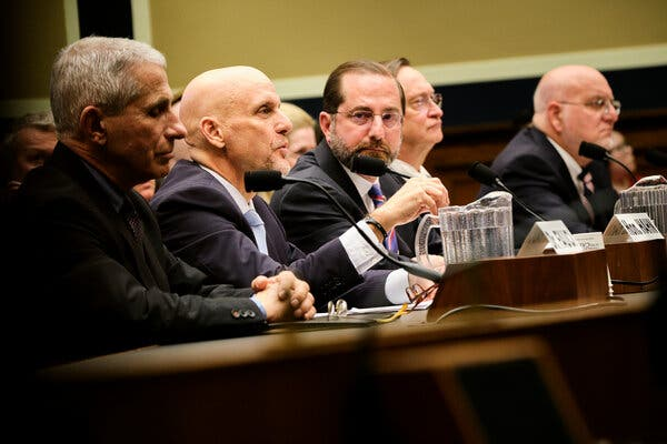 The F.D.A. commissioner,Dr. Stephen Hahn, second from left, testified at a House hearing in Februaryabout the coronavirus outbreak.