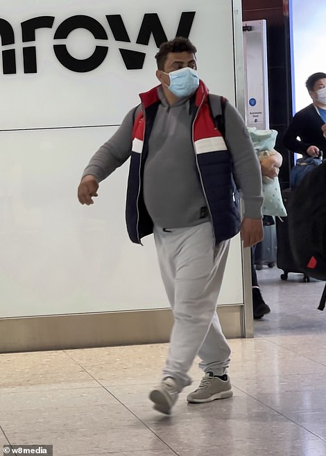 A man arrives at the London airport this afternoon