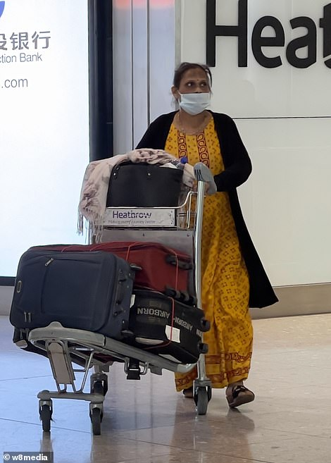 Passengers arrive at Heathrow Terminal 2 from Mumbai this afternoon as travel agents warn of a desperate scramble to beat Friday's quarantine deadline