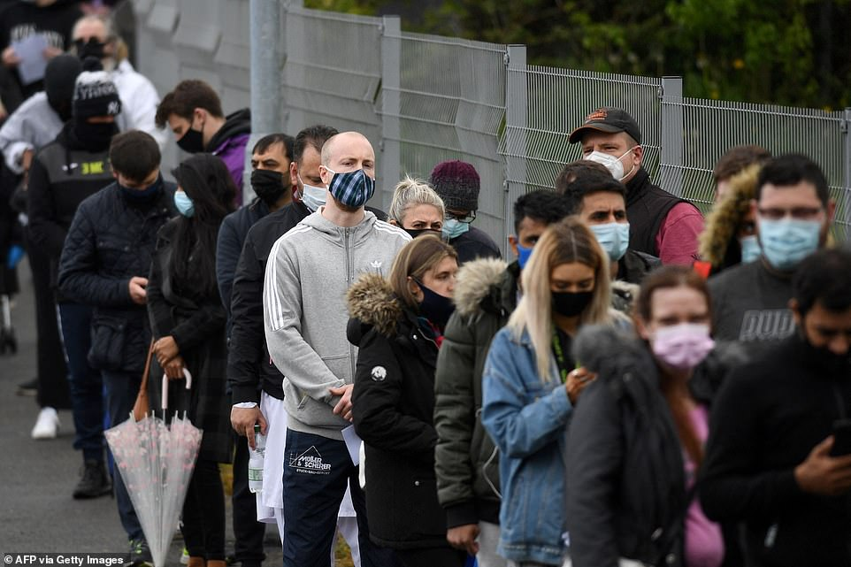 Members of the public in Bolton are pictured queueing for coronavirus vaccines after local health chiefs did away with NHS guidance and said any adult could get a jab – the Government has asked the council and NHS not to break from national policy