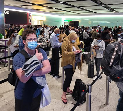 Heathrow travellers have told MailOnline how they were 'terrified of catching Covid' while being crammed into the airport's border hall this morning. Pictured: Passengers queue at the Heathrow border hall today